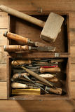 Srtist hand tools for handcraft works. On golden wood background Stock Photo