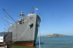 SS Jeremiah OBrien Liberty ship, San Francisco, US. World War II Liberty ship SS Jeremiah OBrien and Alcatraz Island, in Fishermans Wharf, San Francisco Stock Photo