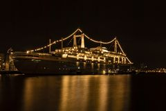 SS Rotterdam by night at Katendrecht quay stock photos