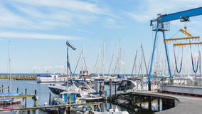 Ssailing yachts at a port of Baltic Sea. Yacht hoist. Northern Germany, coast of Baltic Sea Stock Photography