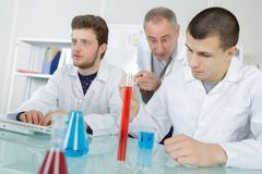 Sscientists going to mix to liquids in lab. Lab royalty free stock photos