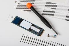 SSD de SATA com chave de fenda fotografia de stock royalty free