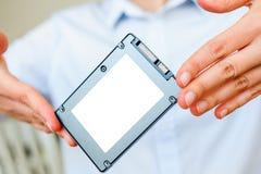 SSD in handen Stock Afbeelding