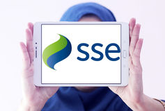 Sse energy company logo. Logo of energy and home services company sse on samsung tablet holded by arab muslim woman stock images