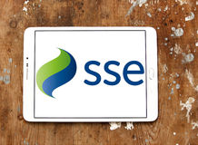 Sse logo. Logo of energy and home services company sse on samsung tablet on wooden background royalty free stock photo