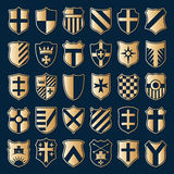 Sset of gold heraldic shields Royalty Free Stock Photos