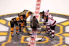 SSGT Michael Downing drops the puck Royalty Free Stock Image
