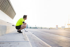 SSports man with running armband on the hand enjoying beautiful morning sunrise with big copy space area for your text message Stock Photography