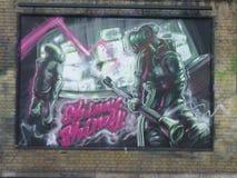 Städtische Kunstgraffiti Londons auf Wand Stockfoto