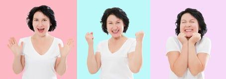 Ställ in av den förvånade chockade upphetsade asiatiska kvinnaframsidan som isoleras på färgrik bakgrund Mellersta ålder som är k arkivbilder