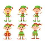 Ställ in av den gulliga lilla julflicka- och pojkeälvan som ler, vektorillustrationen som isoleras på vit bakgrund royaltyfri illustrationer