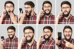 Ställ in av den stiliga emotionella mannen som använder mobiltelefonen arkivfoton