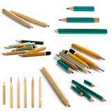 Ställ in av korta blyertspennor på isolerad bakgrund royaltyfria foton