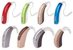 Ställ in av moderna hörapparater på isolerad vit bakgrund, alternativ till kirurgi royaltyfri foto