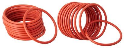 Ställ in av orange hydrauliska och pneumatiska nolla-cirkeln skyddsremsor som isoleras på en vit bakgrund arkivbilder