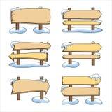 Ställ in av träpekare i snön vektor illustrationer