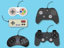 Ställ in av vektorillustration av gamepads för videospel vektor illustrationer
