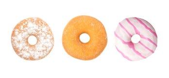 Ställ in Donuts på vit bakgrund, blandade Donuts Arkivfoto
