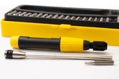 Ställ in en skruvmejsel i svart- och gulingask Royaltyfri Fotografi