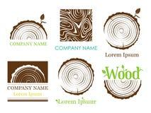 Ställ in ett tvärsnitt av stammen med trädcirklar vektor logo Trädtillväxtcirklar royaltyfri illustrationer