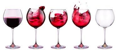 Ställ in från exponeringsglas med vin som isoleras på en vit Arkivfoton