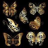 Ställ in guld- fjärilar Arkivfoto