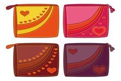 Ställ in handväskor med valentinhjärtor Arkivfoto