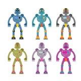 Ställ in kulöra robotar Retro mekaniska leksaker Tappningutrymmecyborgs Royaltyfri Foto