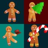 Ställ in mannen för julkakapepparkakan dekorerad med isläggningdans och hagyckel i hatt med julgranen och Arkivbilder