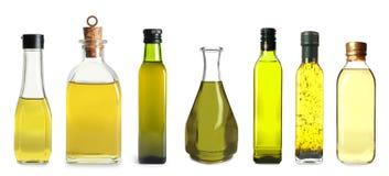 Ställ in med flaskor av olika oljor arkivbild