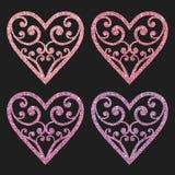 Ställ in samlingen av dekorativa rosa färger blänker hjärtor på en svart bakgrund Arkivfoto