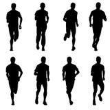 ställ in silhouettes Löpare sprintar på, män Arkivbild