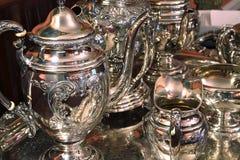 ställ in silverett pund sterlingtea Arkivfoto