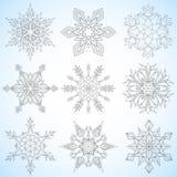 ställ in snowflakes Drog upp konturerna av mandalas Snöflingor för vuxen färgläggningbok eller konstterapi Fotografering för Bildbyråer