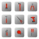 Ställ in vektorsymboler av byggnadshjälpmedel med det orange handtaget Royaltyfri Bild
