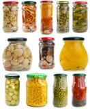 ställde glass jars in för olika frukter grönsaker Arkivfoton