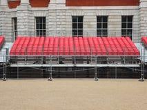 Ställningsplattform med rader av röda plast- platser Fotografering för Bildbyråer
