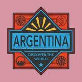 Stämpel- eller tappningemblemet med text Argentina, upptäcker världen Royaltyfri Foto