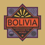 Stämpel- eller tappningemblemet med text Bolivia, upptäcker världen Royaltyfria Bilder