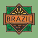 Stämpel- eller tappningemblemet med text Brasilien, upptäcker världen Royaltyfria Foton