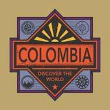 Stämpel- eller tappningemblemet med text Colombia, upptäcker världen Royaltyfri Bild