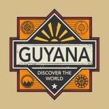 Stämpel- eller tappningemblemet med text Guyana, upptäcker världen Royaltyfri Foto
