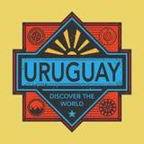 Stämpel- eller tappningemblemet med text Uruguay, upptäcker världen Royaltyfri Foto