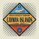 Stämpel- eller tappningemblemtext Caymanöarna, upptäcker världen Fotografering för Bildbyråer