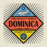 Stämpel- eller tappningemblemtext Dominica, upptäcker världen Royaltyfria Foton