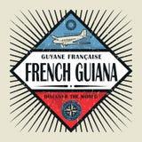 Stämpel- eller tappningemblemtext Franska Guyana, upptäcker världen Arkivfoto