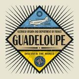 Stämpel- eller tappningemblemtext Guadeloupe, upptäcker världen Royaltyfri Bild