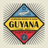Stämpel- eller tappningemblemtext Guyana, upptäcker världen Royaltyfri Foto