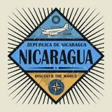 Stämpel- eller tappningemblemtext Nicaragua, upptäcker världen Royaltyfri Bild