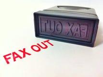 Stämpelfax ut Arkivbild